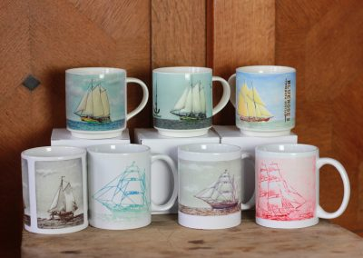 All 7 classic ship mug designs on a photo